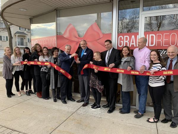 Business Leaders Gather To Celebrate Grand Reopening Of