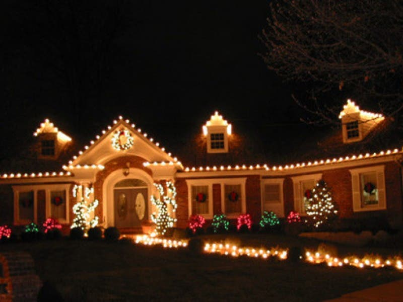 hanging with holiday outdoor decorating services 0 - Christmas Decorating Companies