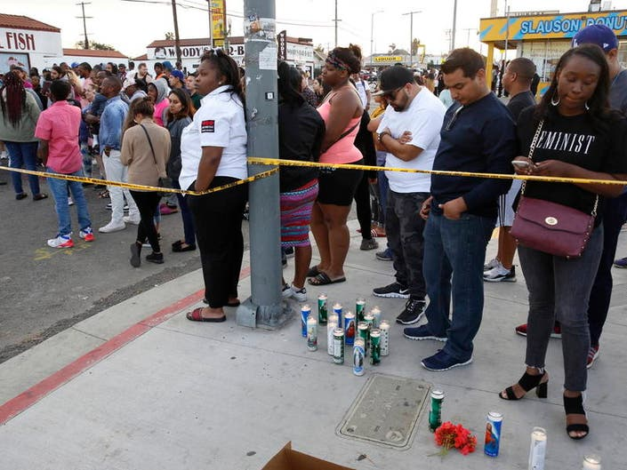 0719d2a8def3cb People set candles behind police yellow tape next to the Marathon Clothing  store of rapper Nipsey
