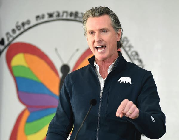 California Gov. Gavin Newsom speaks during a press conference, Friday Feb. 26, 2021, after visiting a COVID-19 vaccination clinic for farmworkers at the Dr. Sharon Stanley-Rea Community Center in Fresno, Calif.