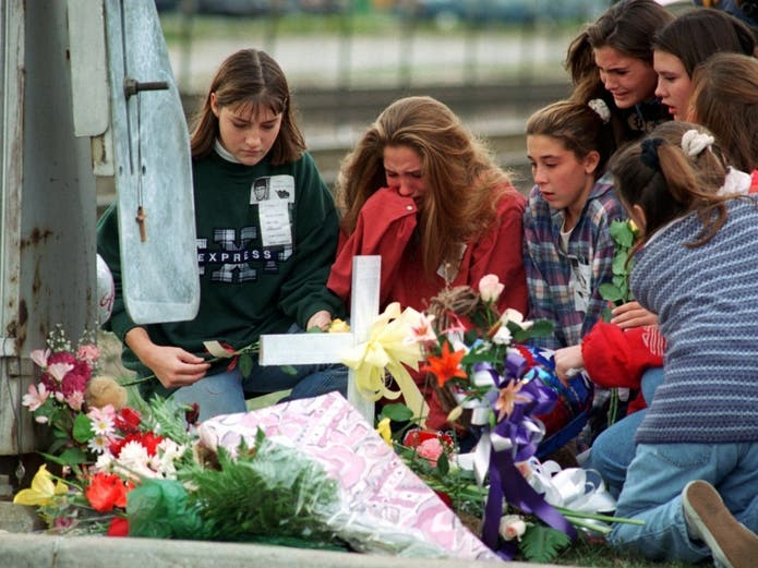 Students from Cary-Grove High School grieve Thursday, Oct. 26, 1995, while visiting the memorial at the train crossing in Fox River Grove, Ill., where fellow students were killed Wednesday when a commuter train slammed into their school bus.