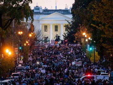 People gather in Black Lives Matter Plaza near the White House as they celebrate after Democratic nominee Joe Biden was declared winner of the 2020 presidential election.