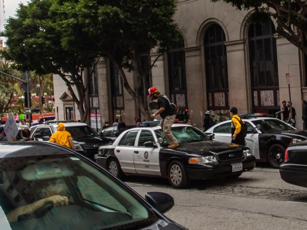 Cops And Reporter Hurt As Protesters Loot Downtown LA Businesses