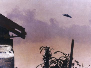 This undated photo taken by Mrs. Paul Trent purports to show an unidentified flying object over McMinnville, Oregon. Each year, residents of Illinois submit reports to the National UFO Reporting Center.