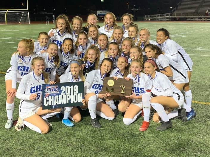 Glastonbury players celebrate their 1-0 win over Southington in the Class LL girls soccer finals Saturday.