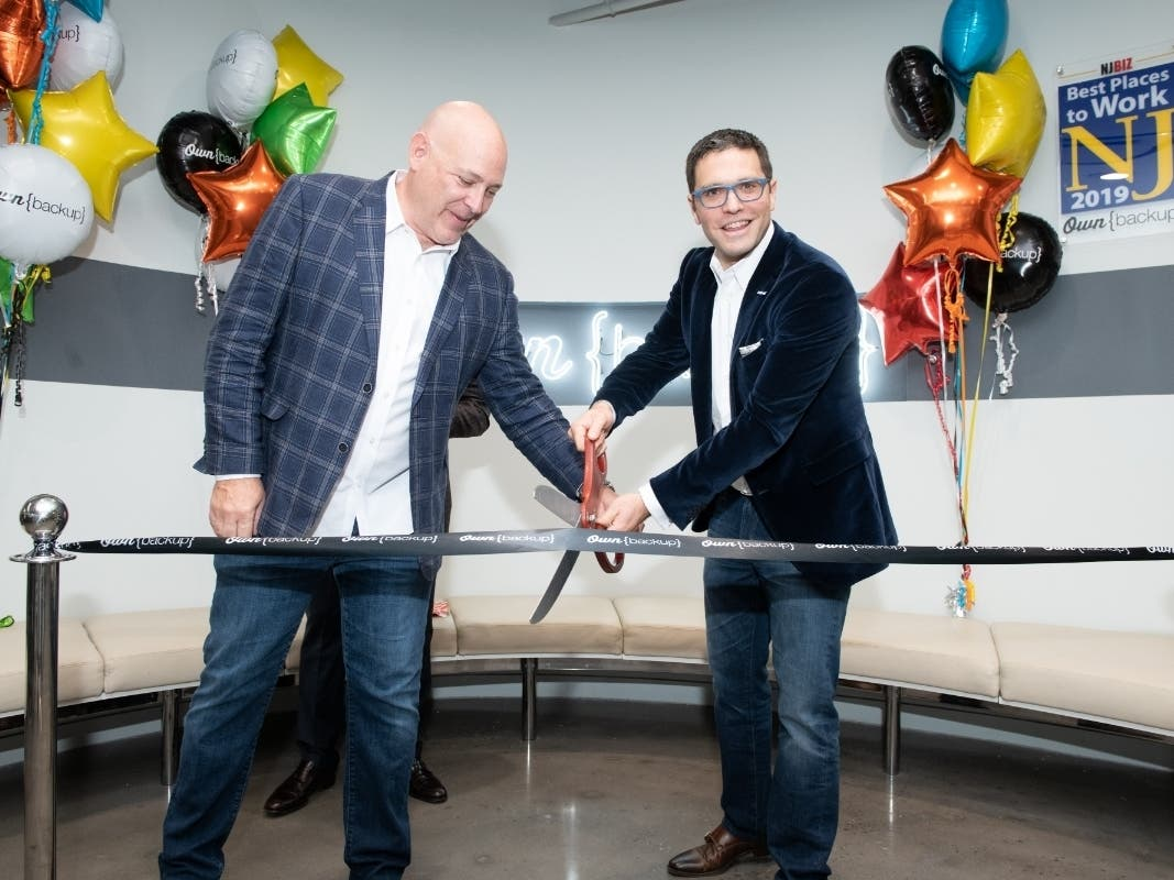 OwnBackup Vice President of Sales Charles Johnston and CEO Sam Gutmann cut the ribbon at the company's new Englewood Cliffs headquarters on Sunday.