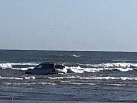 Vehicle In Surf At Smith Point Sparks Water Rescue