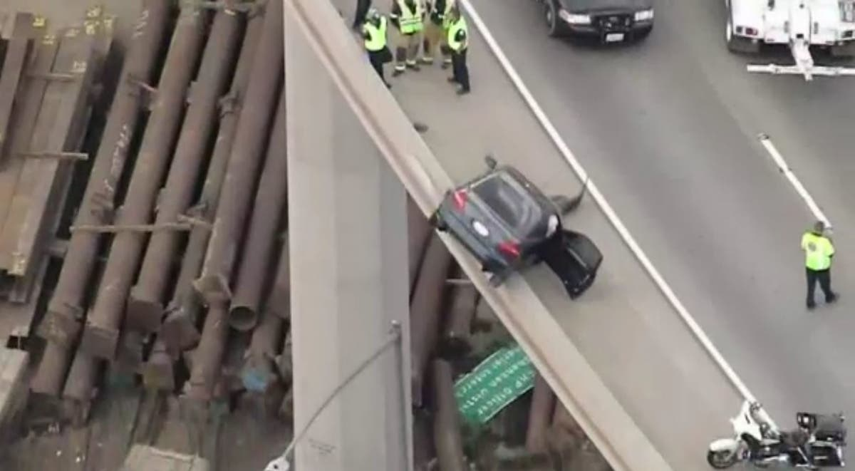 Car Hangs On Edge Of 15/91 Transition Road In Corona After Crash