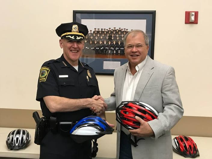 Breakstone, White & Gluck Donates Kids Helmets to Norwood Police