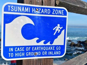 A tsunami threat was being evaluated Thursday for the West Coast of the United States following an earthquake near the Kermadec Islands of New Zealand.
