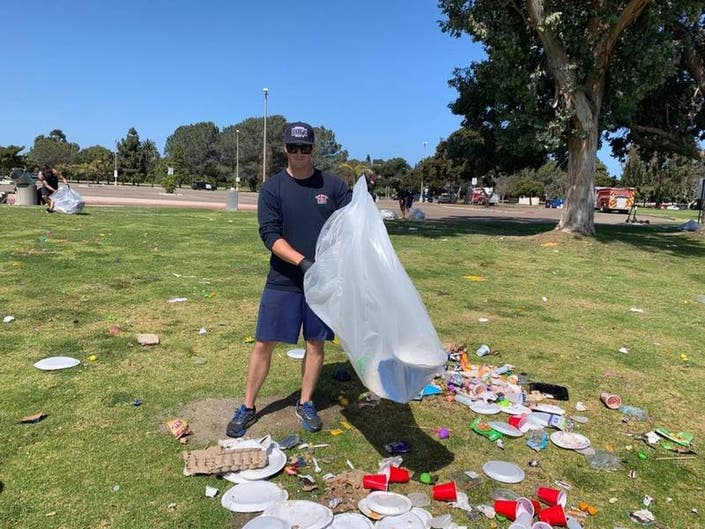 Firefighters Help Pick Up Park Trash Left By Weekend Revelers