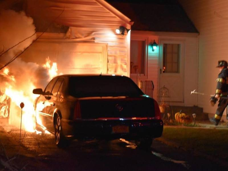 Firefighters Extinguish Garage Car Fire In East Northport