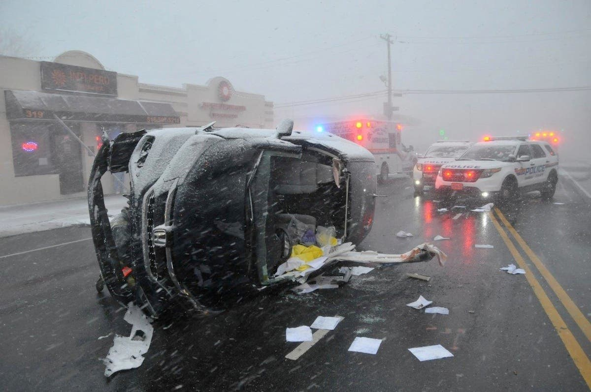 Driver Rescued From Overturned Vehicle During Snow Squall