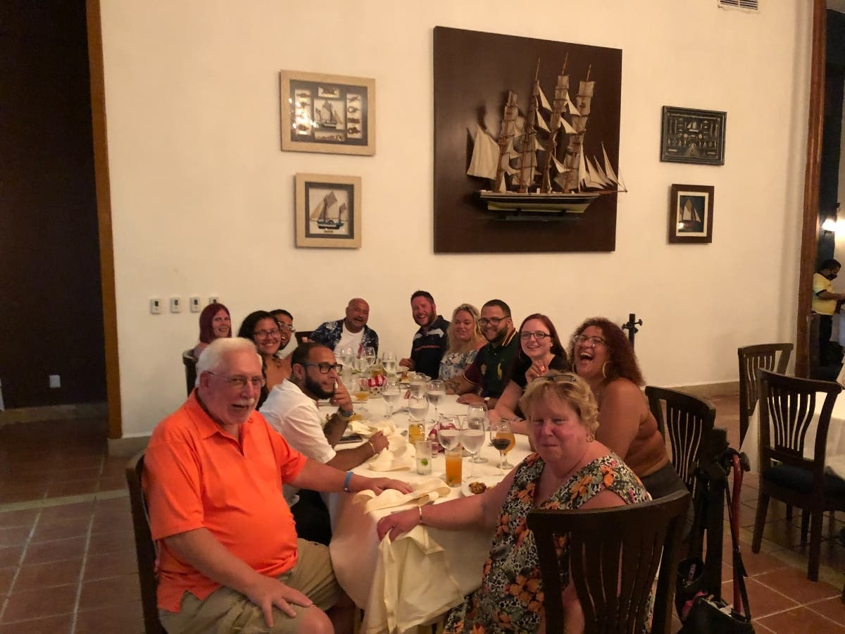 Trionfo, in orange, with his wife, children and grandchildren in Cancun, Mexico earlier this July.