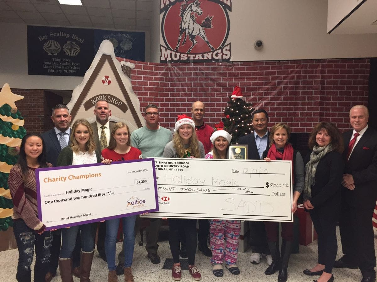 Altice Connects Charity Champions Check Presentation to