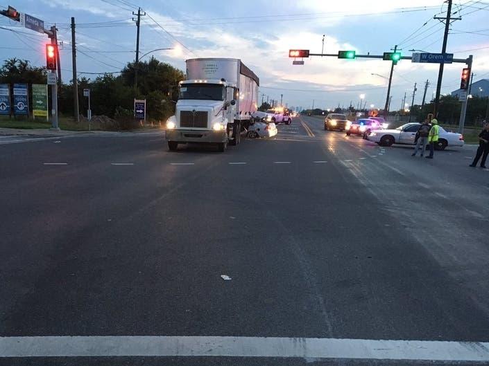 Woman Crashes Into 18-Wheeler While Evading Police
