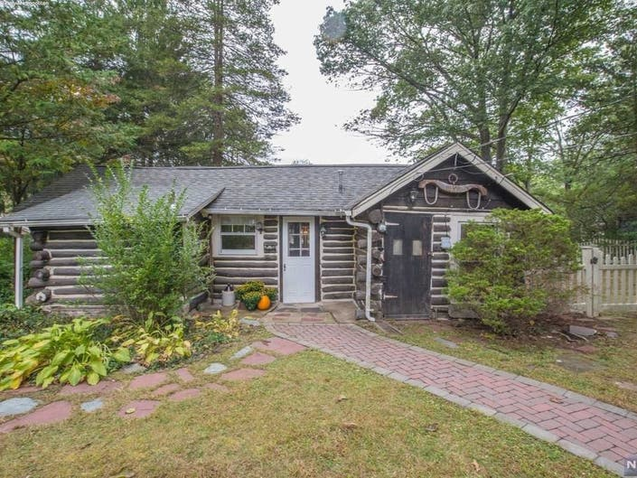 Lakefront Chestnut Log Cabin Listed In Morris Co. For $325K