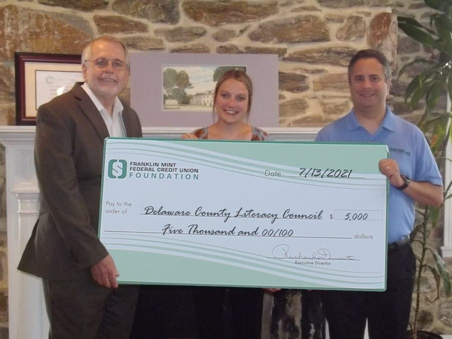 Rick Durante, Executive Director of Franklin Mint Federal Credit Union Foundation, at right, along with Danielle Griffin, Foundation Program Manager, present a $5,000.00 donation to Pat Gunnin, at left, Executive Director of Delaware Literacy Council.