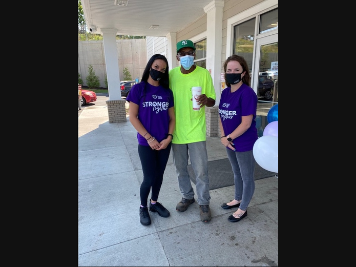 Centers' Capital Community Liaison Danielle Donato, Left, and Malerie Bafaro, Centers' Albany Center For Independent Living Liaison, Right, With a Happy Customer in Troy.