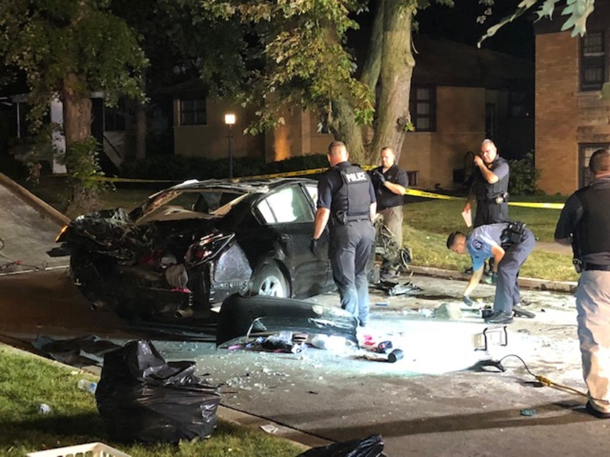 Fleeing Armed Robbers Crash Into Tree, Get Ejected From Car