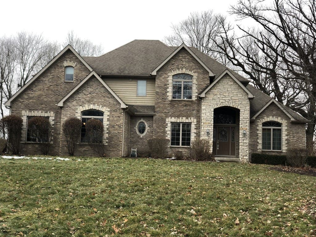 $479K Home With 3-Car Garage, Screened-In Porch, In-Ground Pool