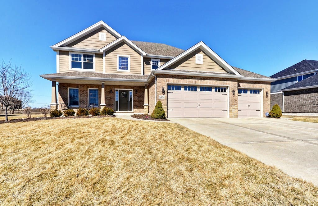 $419K Home With 3-Car Garage, Butler's Pantry, Master Suite