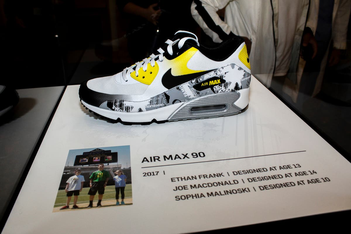 The new Nike designs created by three childhood cancer survivors can be  seen on this Air Max 90 sneaker. Photo  Travis Loose 90ecba265
