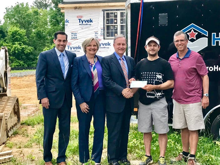 Coldwell Banker Presents Donation to Hero Homes for Disabled