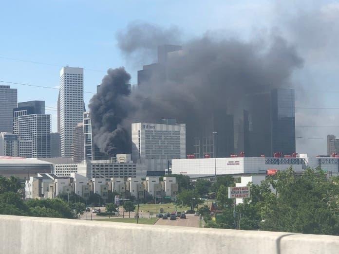 Thick, Black Smoke Billows Out Of Hilton Americas-Houston (Watch)