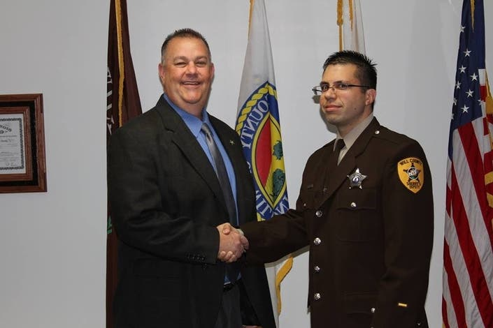 At left, Sheriff Mike Kelley congratulates Nathan Musur on his 2017 sergeant's promotion. It did not last long.