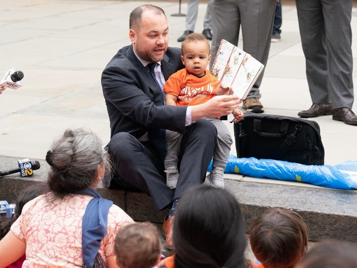 City Council Speaker Corey Johnson reads to toddlers outside City Hall on May 29, 2019.