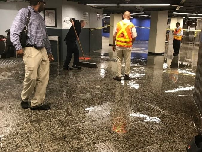 Subway Chief Helps Clean Up Wet Mess At Grand Central