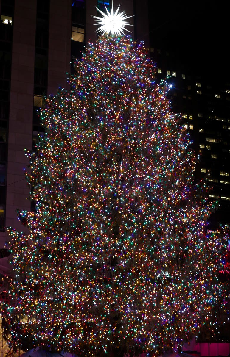 People attend the 86th annual Rockefeller Center Christmas Tree Lighting Ceremony in New York City. (Photo by Brent N. Clarke/Invision/AP)