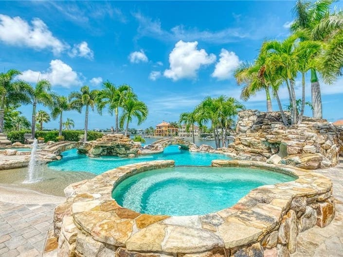 Waterfront Home Features Resort-Style Pool With Spas