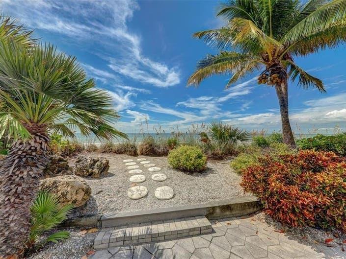 Own 2 Key West-Style Beach Houses On Treasure Island