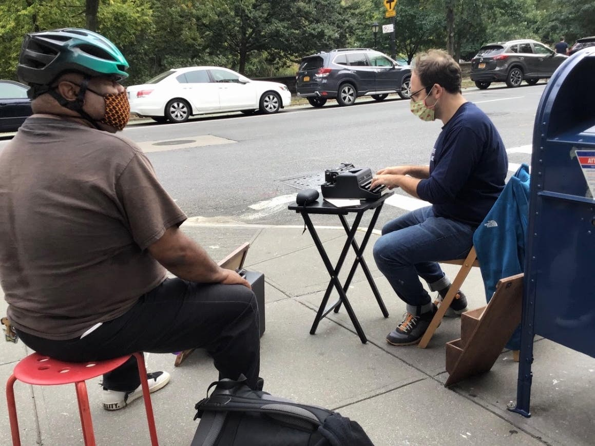 Brandon Woolf is helping New Yorkers connect through the coronavirus crisis by typing and mailing letters from a Park Slope street corner.