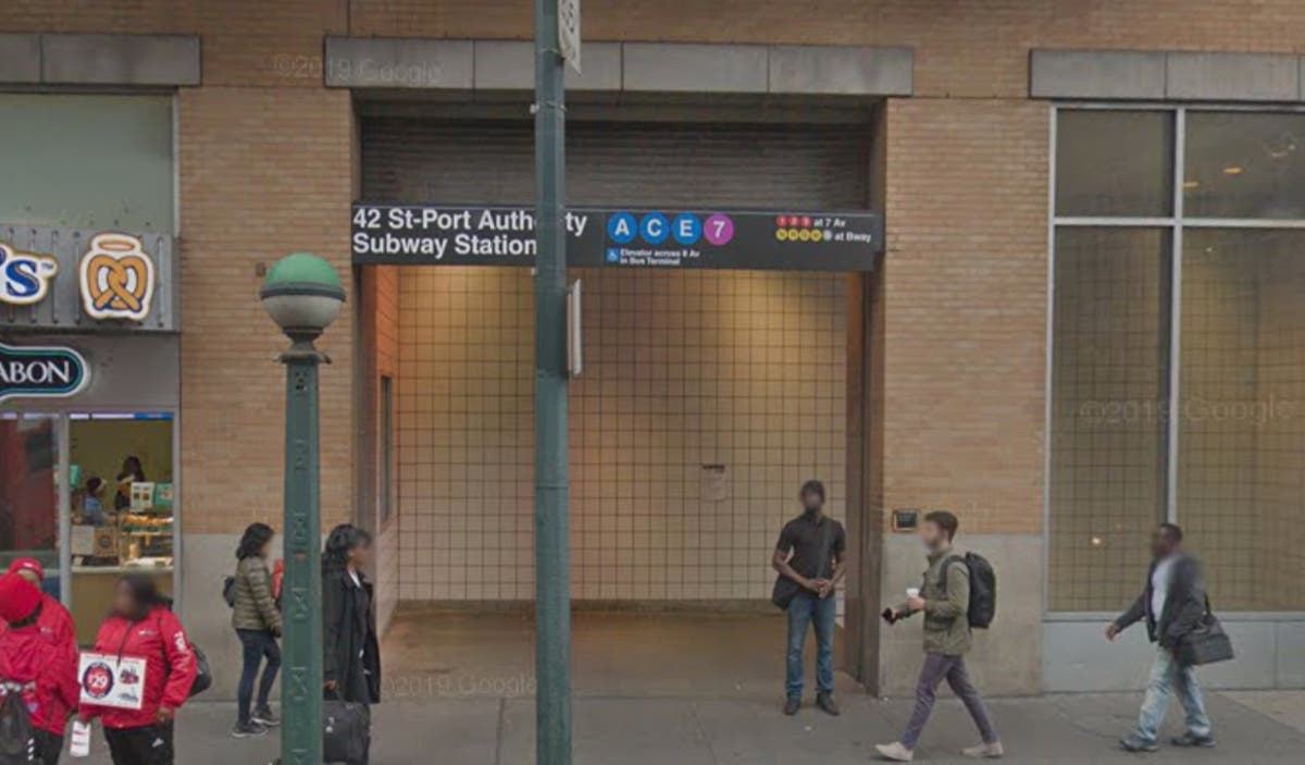 Man Looking At Subway Map.Woman With Blue Hair Stabs Man On Subway Near Times Square Nypd