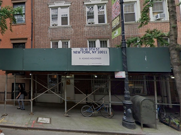 An image of the sidewalk scaffolding shed at 24-26 West 9th Street.