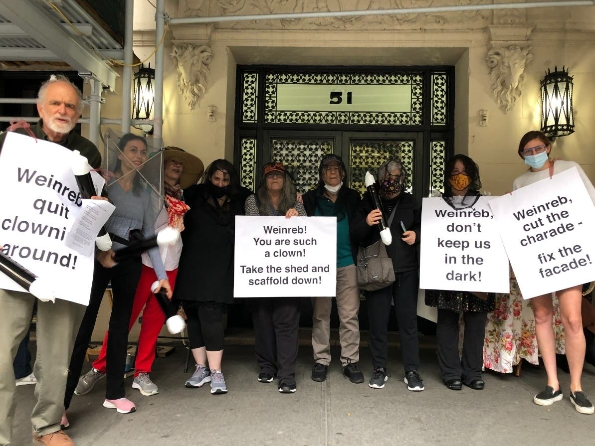 An image of 51 West 86th Street residents who held a mock anniversary party on Saturday for the building's sidewalk shed.