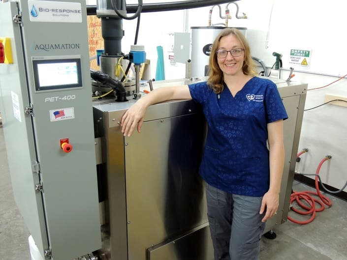 Dr. Kellie Barrett and the aquamation machine at her office.