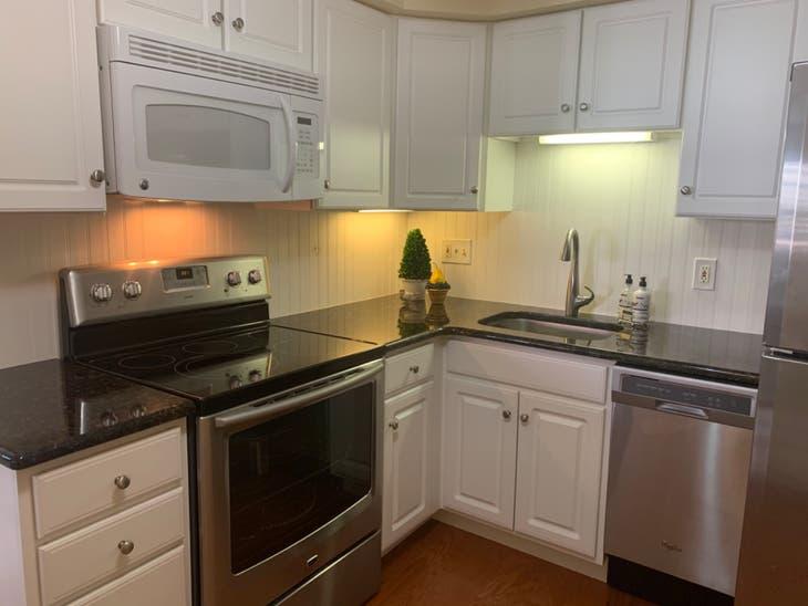 Kitchen cabinets , granite counters, stove / oven