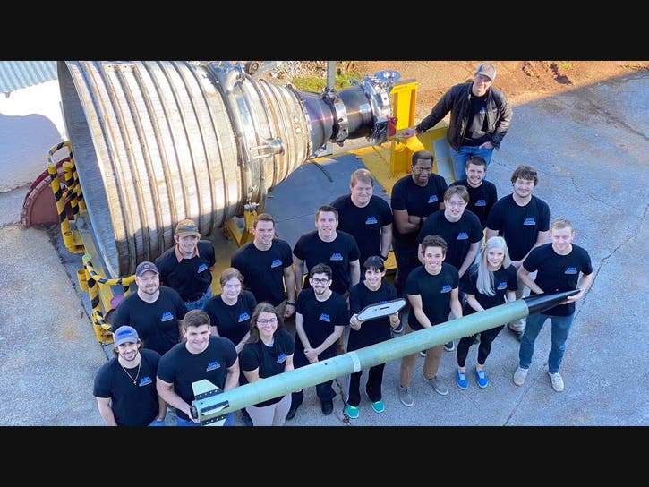The student team with Baedor, its entry for the NASA Student Launch.