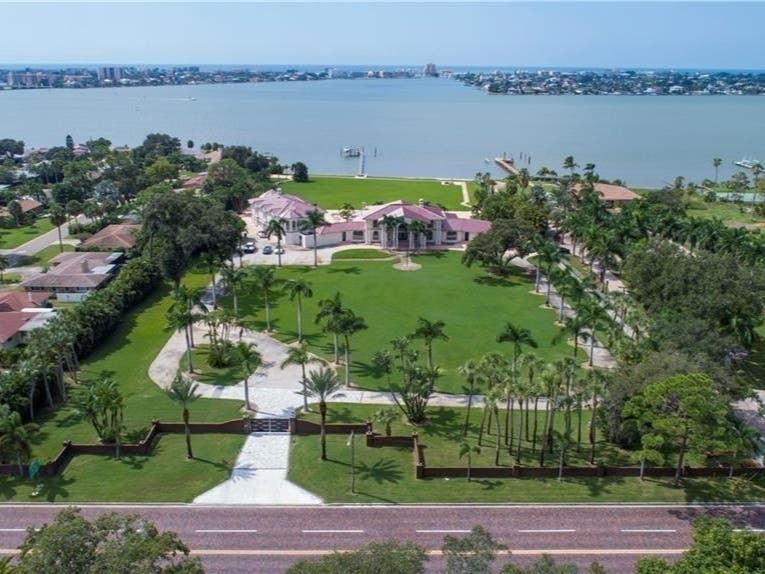 A Magnificent Waterfront Home With 5 1/2 Acres Of Landscape