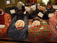 "... Lourdes ""Share and Care"" Event Brings Gifts to Families ..."