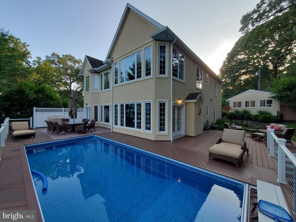 $1.3M Waterfront Mansion Touts Saltwater Pool, Spiral Staircase