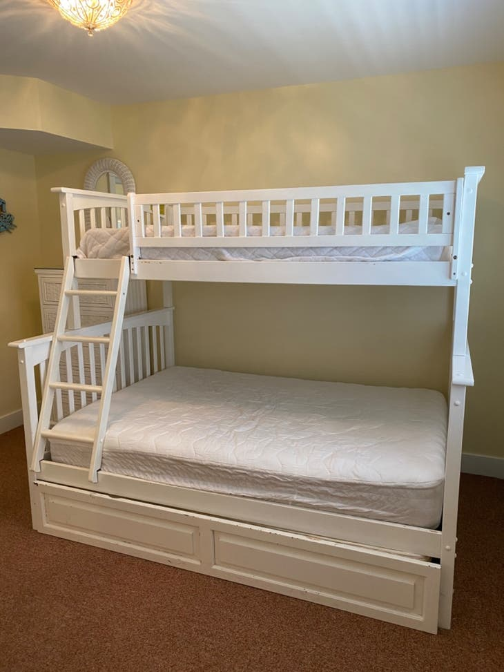 Twin over full bunk unit with twin trundle. $75