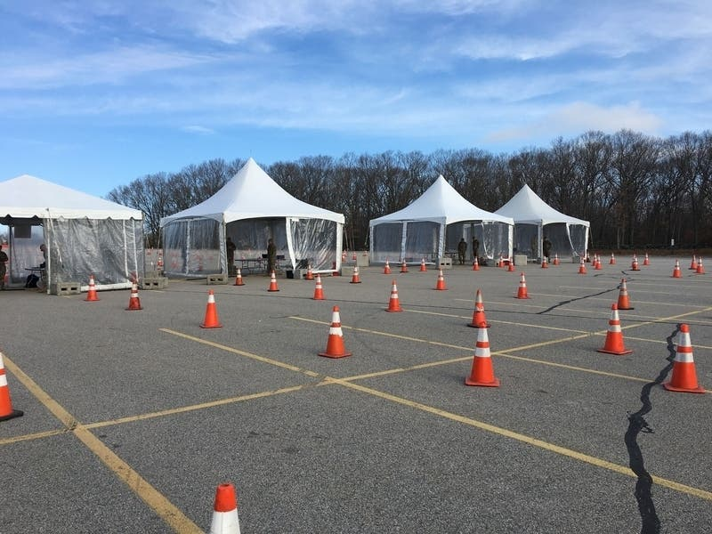 A coronavirus testing center is set up in a community college parking lot.