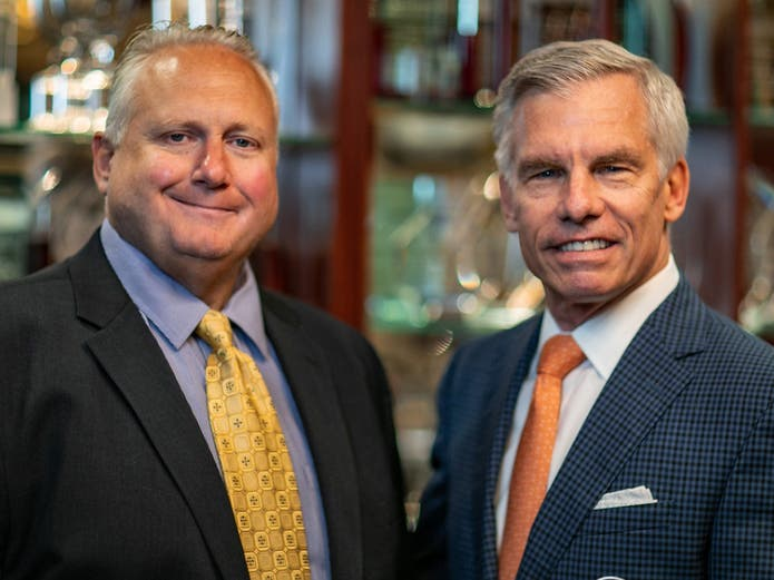 Michael Hastava, left, and James C. Metzger enter into partnership agreement.