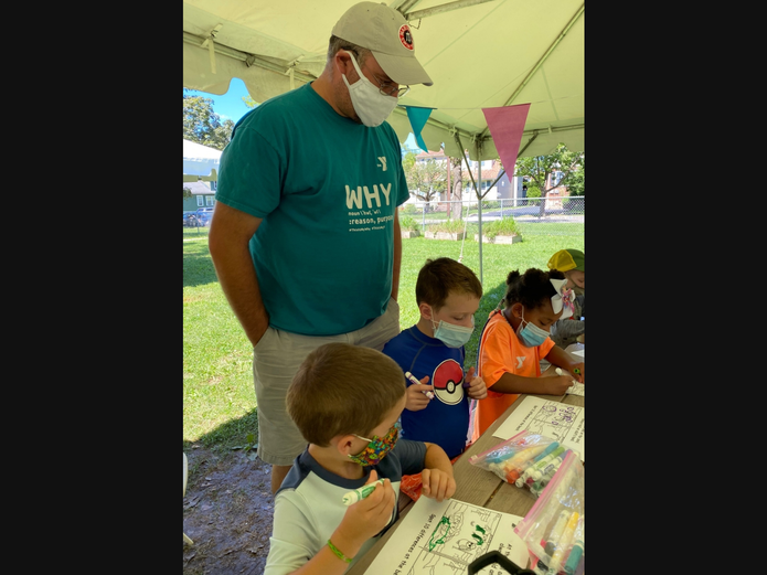Pictured completing a water safety coloring activity during camp are Quest Campers Paul Perconte and Luca Campbell, both age 5 from Madison and Amora Dubeau, also age 5 from Chatham with Madison Area YMCA Competitive Aquatics Director Jon Siegel.