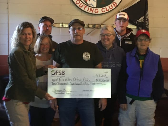 Non-Profit Outing Club Receives Celebratory Donation From Bank